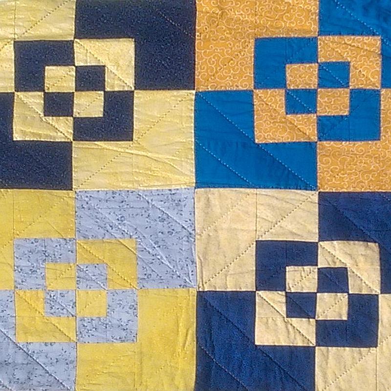 Decke in blau und gelb